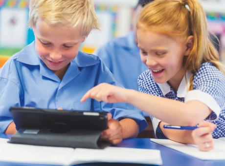 Children in school uniform on device